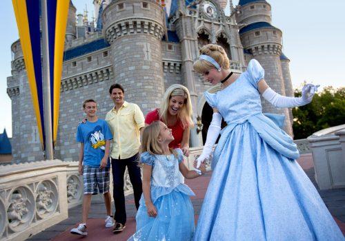 Cinderella and family at Cinderella Castle at Magic Kingdom Park © Disney